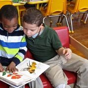 Photo of two kids reading